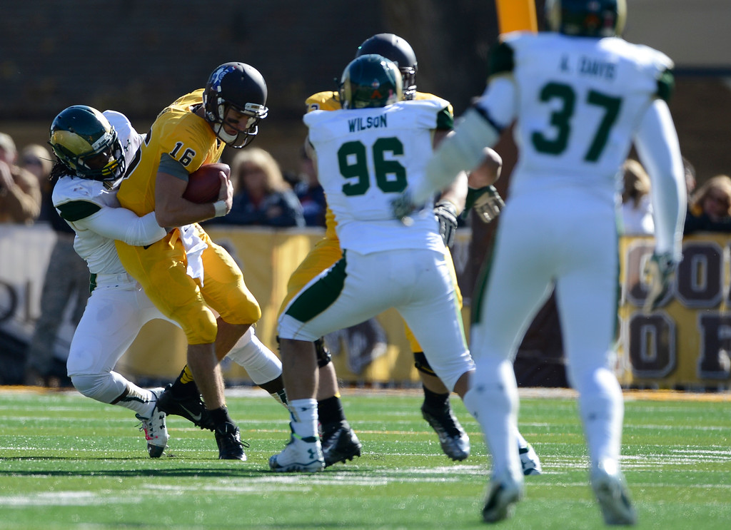 . Colorado State defender, Steven Michel, left, sacks Wyoming QB, Brett Smith in the third quarter of play  at Jonah Field at War Memorial Stadium Saturday, October 19, 2013. (Photo By Andy Cross/The Denver Post)