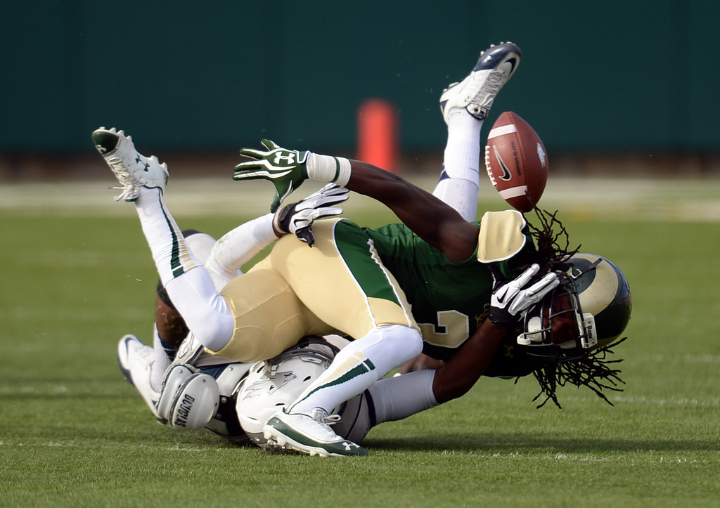 . Shaq Bell of Colorado State University (3) breaks the catch of Hasaan Henderson of University of Nevada (12) in the 1st quarter of the game at Hughes Stadium in Fort Collins, Colorado on November 09, 2013. (Photo by Hyoung Chang/The Denver Post)