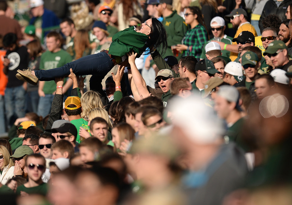 . Colorado State University students celebrate after scoring during the game against University of Nevada at Hughes Stadium in Fort Collins, Colorado on November 09, 2013. CSU won 38-17. (Photo by Hyoung Chang/The Denver Post)
