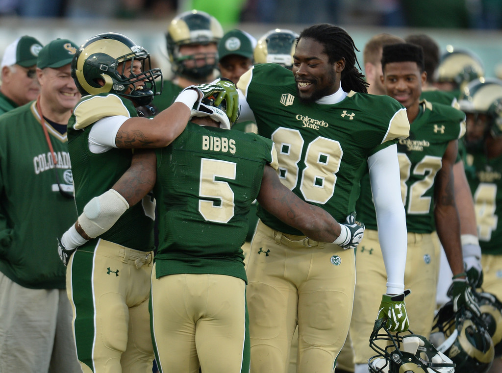 . Kapri Bibbs of Colorado State University (5) celebrates his 85-yard rushing touchdown with Josh Bowman (9) and Elroy Masters, Jr. (88) in the 4th quarter of the game against University of Nevada at Hughes Stadium in Fort Collins, Colorado on November 09, 2013. CSU won 38-17. (Photo by Hyoung Chang/The Denver Post)