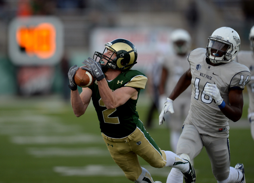 . Thomas Coffman of Colorado State University (2) completes a pass from Garrett Grayson (18) for 41 yards in the 4th quarter of the game against University of Nevada at Hughes Stadium in Fort Collins, Colorado on November 09, 2013. CSU won 38-17. (Photo by Hyoung Chang/The Denver Post)
