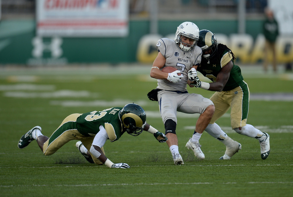 . Shaq Bell of Colorado State University (3) tackles Richy Turner of University of Nevada (2) near Bernard Blake of Colorado State University (23) in the 4th quarter of the game at Hughes Stadium in Fort Collins, Colorado on November 09, 2013. CSU won 38-17. (Photo by Hyoung Chang/The Denver Post)
