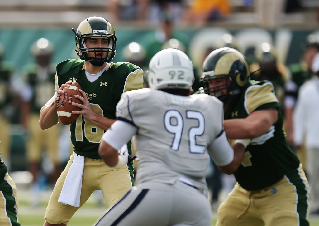 . Garrett Grayson of Colorado State University (18) controls the ball against University of Nevada in the 1st half of the game at Hughes Stadium in Fort Collins, Colorado on November 09, 2013. (Photo by Hyoung Chang/The Denver Post)