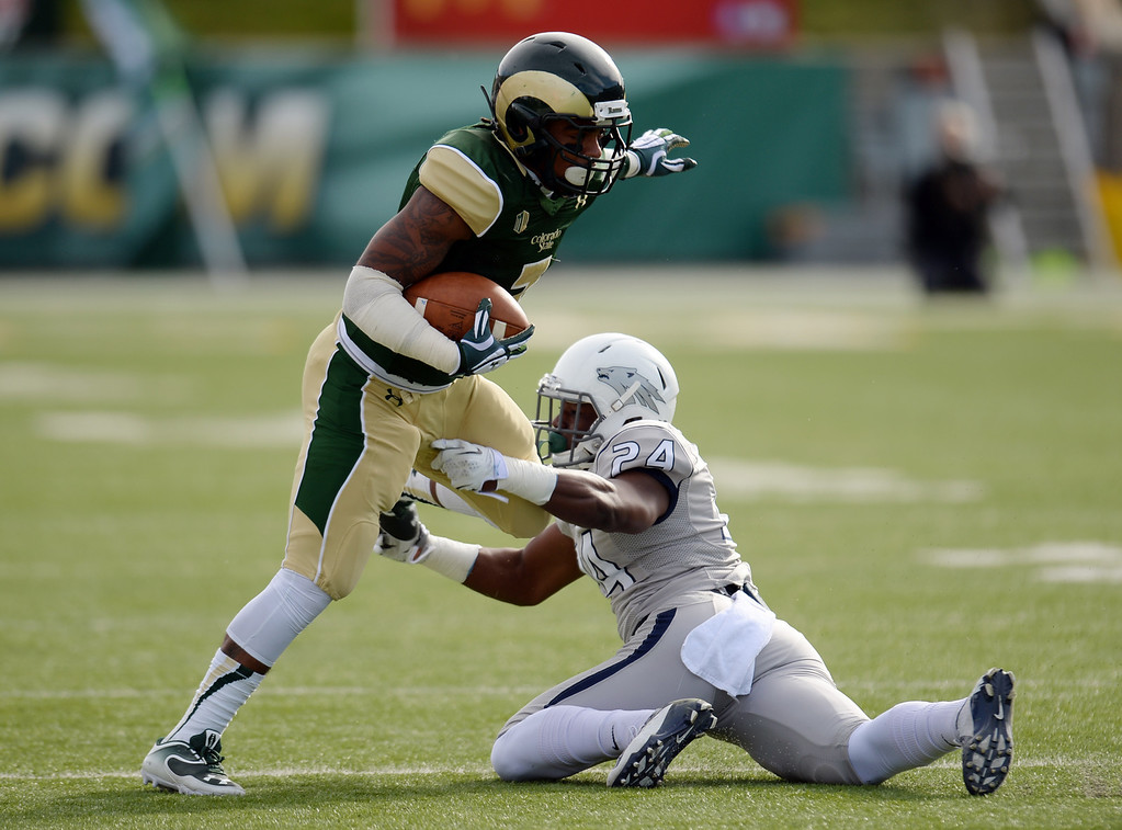 . Donnell Alexander of Colorado State University (3) escapes from being tackled by Charles Garrett of University of Nevada (24) in the 1st half of the game at Hughes Stadium in Fort Collins, Colorado on November 09, 2013. CSU won 38-17. (Photo by Hyoung Chang/The Denver Post)