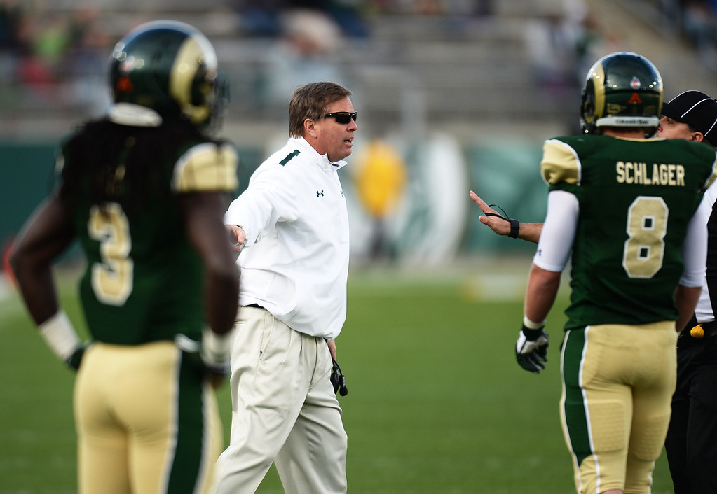. Head coach Jim McElwain of Colorado State University argues about a play to a referee during the 4th quarter of the game against University of Nevada at Hughes Stadium in Fort Collins, Colorado on November 09, 2013. CSU won 38-17. (Photo by Hyoung Chang/The Denver Post)