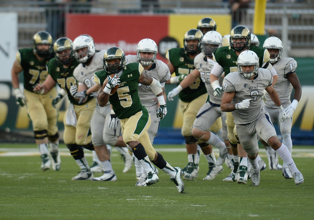 . Kapri Bibbs of Colorado State University (5) rushes for a 85-yard touchdown in the 4th quarter of the game against University of Nevada at Hughes Stadium in Fort Collins, Colorado on November 09, 2013. CSU won 38-17. (Photo by Hyoung Chang/The Denver Post)