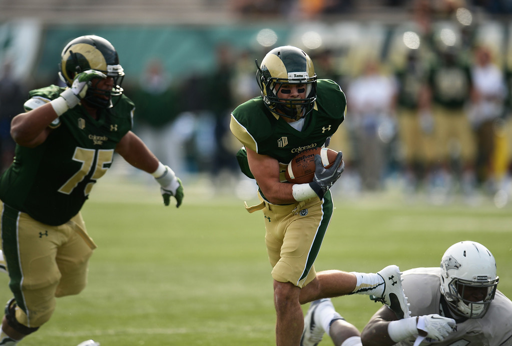 . Joe Hansley of Colorado State University (25) controls the ball against  University of Nevada defense in the 1st quarter of the game at Hughes Stadium in Fort Collins, Colorado on November 09, 2013. CSU won 38-17. (Photo by Hyoung Chang/The Denver Post)