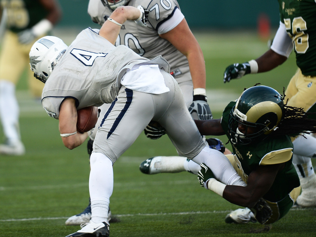 . Shaq Bell of Colorado State University (3) tackles Kendall Brock of University of Nevada (4) in the 4th quarter of the game at Hughes Stadium in Fort Collins, Colorado on November 09, 2013. CSU won 38-17. (Photo by Hyoung Chang/The Denver Post)