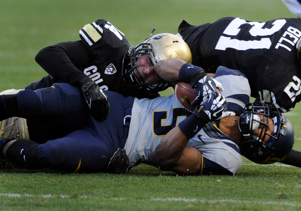 . BOULDER, CO - NOVEMBER 16: CU\'s Addison Gillam (44) takes down Cal\'s Brendan Bigelow (5) in the first half. The University of Colorado football team takes on the University of California in the first quarter at Folsom Field in Boulder. (Photo by Kathryn Scott Osler/The Denver Post)