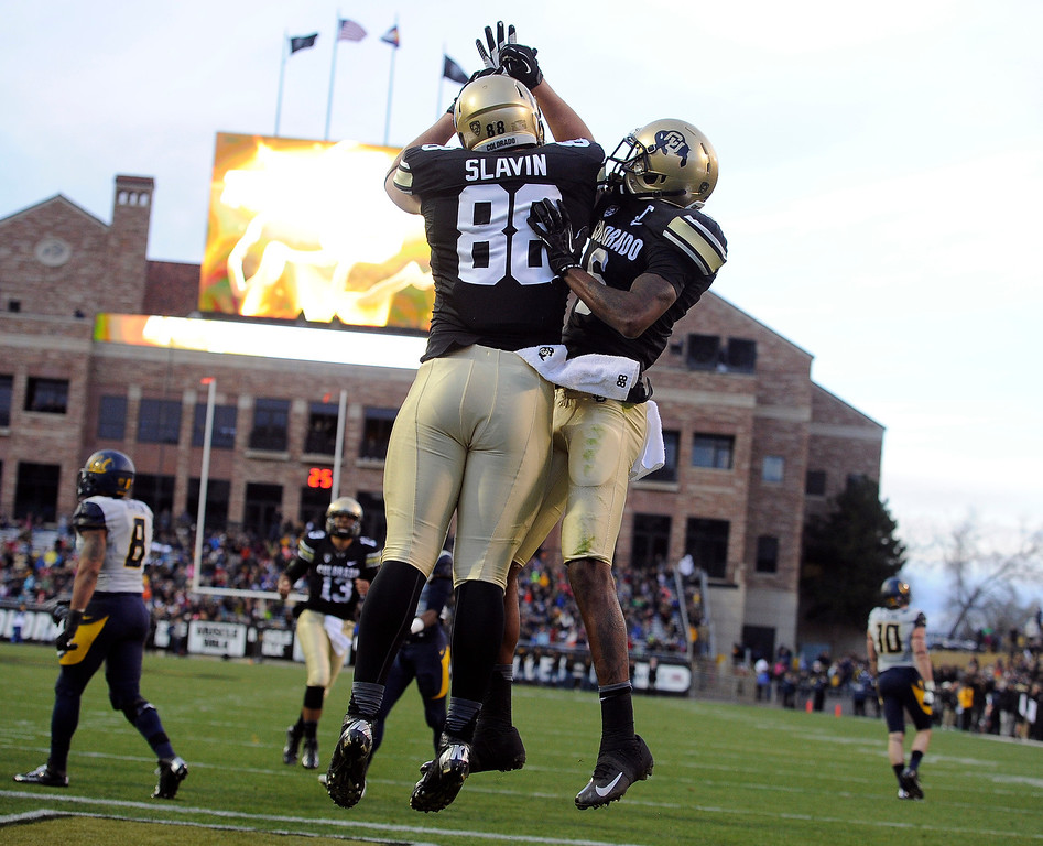 . BOULDER, CO - NOVEMBER 16: CU\'s Kyle Slavin (88) celebrates with his teammates after his second quarter TD. The University of Colorado football team takes on the University of California in the first quarter at Folsom Field in Boulder. (Photo by Kathryn Scott Osler/The Denver Post)