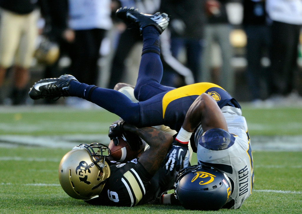 . BOULDER, CO - NOVEMBER 16: CU\'S Paul Richardson (6) comes down with the catch against Cal\'s Cedric Dozier (37).The University of Colorado football team takes on the University of California in the first quarter at Folsom Field in Boulder. (Photo by Kathryn Scott Osler/The Denver Post)