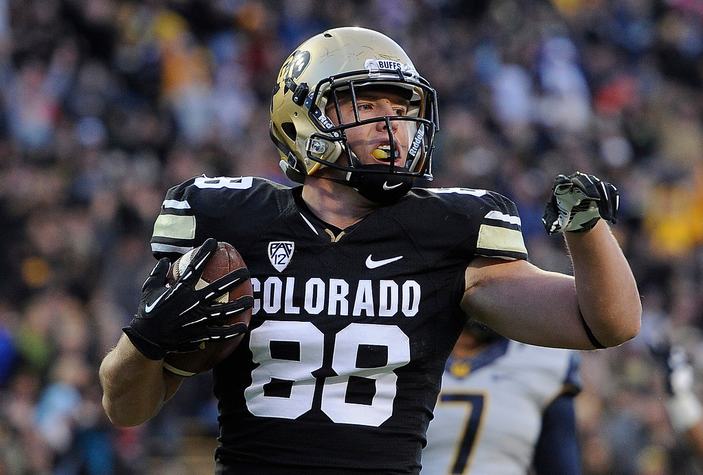 . BOULDER, CO - NOVEMBER 16: CU\'s Kyle Slavin (88) gestures toward his teammates after his second quarter TD. The University of Colorado football team takes on the University of California in the second quarter at Folsom Field in Boulder. (Photo by Kathryn Scott Osler/The Denver Post)