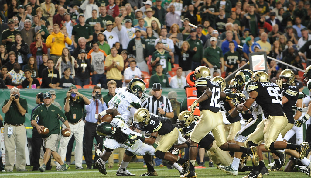 . DENVER, CO - AUGUST 29: CSU running back Dee Hart lunges across the goal line for a touchdown in the second quarter against CU at Sports Authority Field at Mile High on Friday, August 29, 2014.  (Photo by Steve Nehf/The Denver Post)