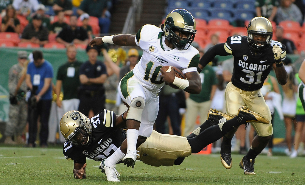 . DENVER, CO - AUGUST 23: CSU running back Dee Hart eludes tacklers in the first quarter against CU at Sports Authority Field at Mile High on Saturday, August 29, 2014 in Denver, Colorado.  (Photo by Steve Nehf/The Denver Post)
