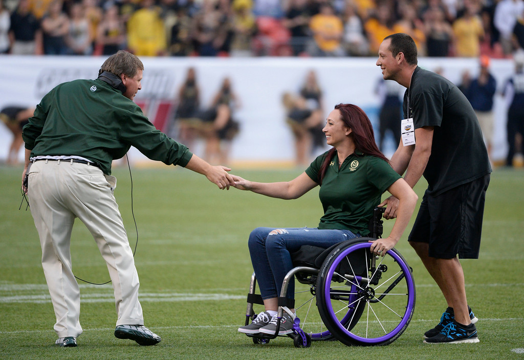 . DENVER, CO. - AUGUST 29:  Colorado State Rams head coach, Jim McElwain, left, shakes hands with Amy Van Dyken, just before the game started against Colorado University at the Rocky Mountain Showdown at Sports Authority Field at Mile High Friday evening, August 29, 2014. Van Dyken was out at mid-field for the coin toss. (Photo By Andy Cross / The Denver Post)