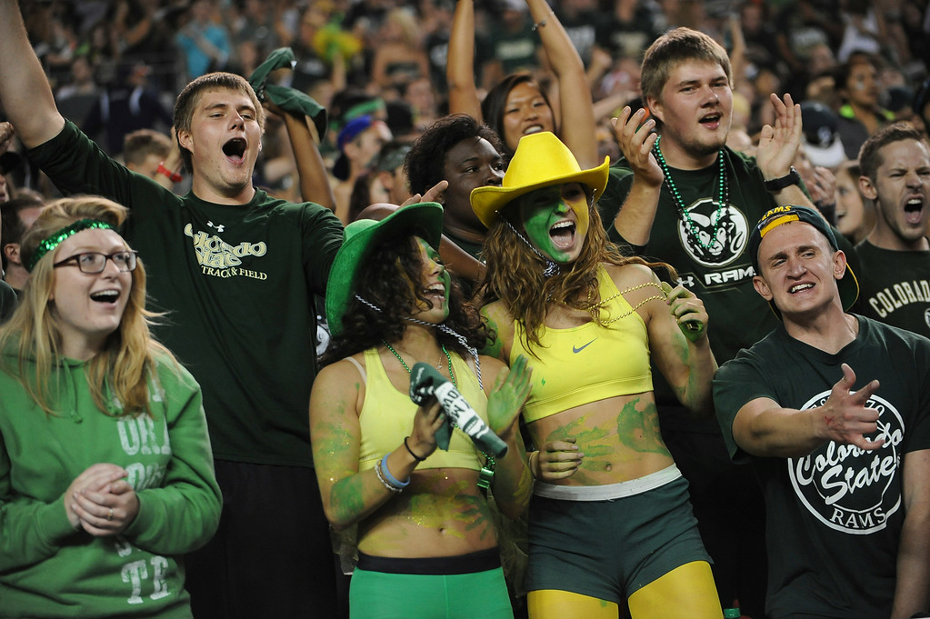 . DENVER, CO - AUGUST 29: CSU fans cheer running back Dee Hart\'s touchdown in the second quarter against CU at Sports Authority Field at Mile High on Friday, August 29, 2014.  (Photo by Steve Nehf/The Denver Post)