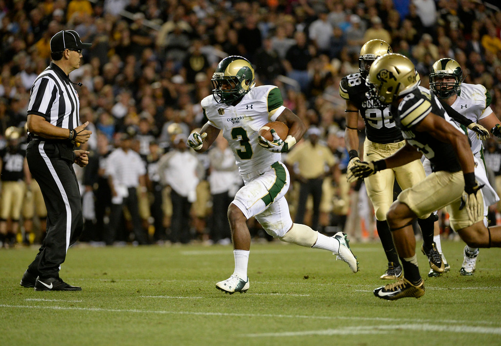 . DENVER, CO. - AUGUST 29: Colorado State RB, Treyous Jarrells, gains long yardage against the Colorado University defense near the end zone in the third quarter at the Rocky Mountain Showdown at Sports Authority Field at Mile High Friday evening, August 29, 2014. (Photo By Andy Cross / The Denver Post)