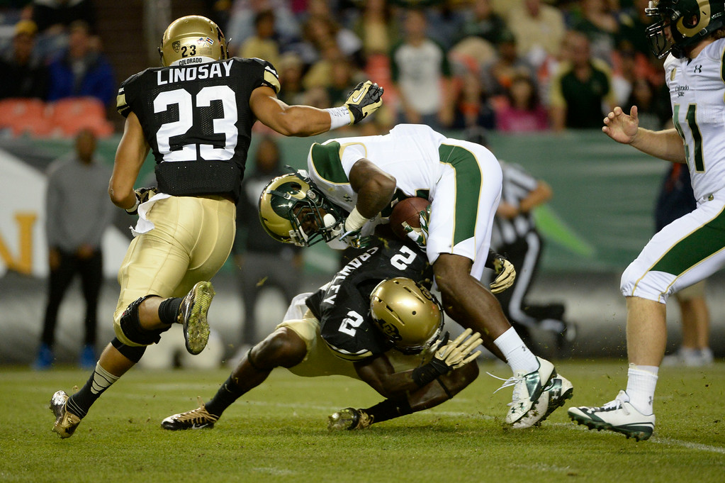 . DENVER, CO. - AUGUST 29:  Deionte Gaines, CSU, gets upended coming out of the end zone on a punt return by Colorado University DB, Kenneth Crawley, in the second quarter of play during the Rocky Mountain Showdown at Sports Authority Field at Mile High Friday evening, August 29, 2014. Phillip Lindsay, gets in on the play. (Photo By Andy Cross / The Denver Post)