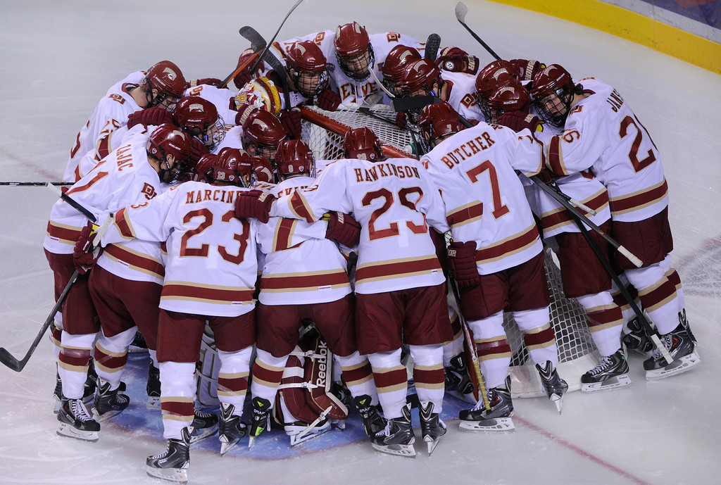 . DENVER, CO. - OCTOBER 11: The Pioneers circled around goaltender Sam Britain for a pep talk before the  first period Friday night. The University of Denver men\'s hockey team hosted Merrimack at Magness Arena Friday night, October 11, 2013. Photo By Karl Gehring/The Denver Post