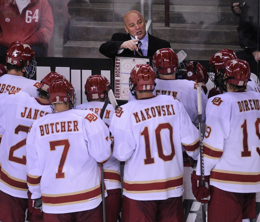 . DENVER, CO. - OCTOBER 11: Denver coach Jim Montgomery drew up a plan for the last minute in the third period when Merrimack pulled its goaltender. The University of Denver men\'s hockey team defeated Merrimack 1-0 at Magness Arena Friday night, October 11, 2013. Photo By Karl Gehring/The Denver Post