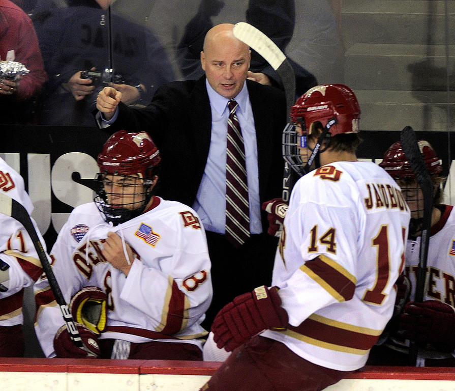 . DENVER, CO. - OCTOBER 11: Pioneers coach Jim Montgomery shared a word with left wing Larkin Jacobson (14) in the first period. The University of Denver men\'s hockey team hosted Merrimack at Magness Arena Friday night, October 11, 2013. Photo By Karl Gehring/The Denver Post