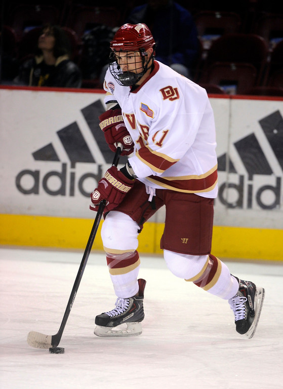 . Denver defenseman Nolan Zajac skated before the game. The University of Denver hockey team hosted Colorado College at Magness Arena Saturday night, November 9, 2013. Photo By Karl Gehring/The Denver Post