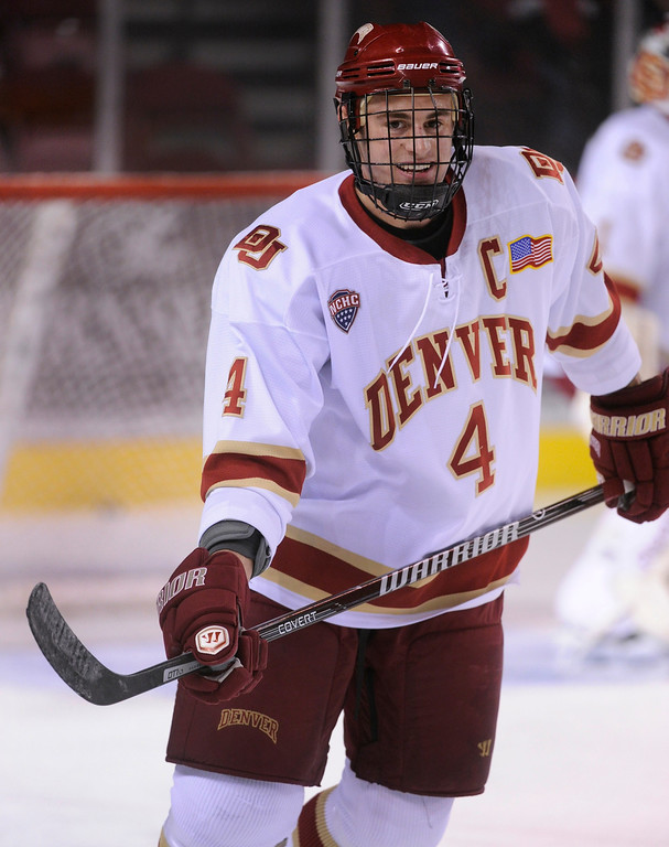 . Denver defenseman Josiah Didier skated before the game. The University of Denver hockey team hosted Colorado College at Magness Arena Saturday night, November 9, 2013. Photo By Karl Gehring/The Denver Post
