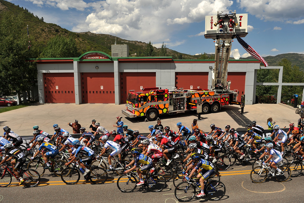 . The pack of cyclists pass Snowmass Fire House No.1 during Stage 1 of the 2013 USA Pro Challenge race in Aspen, Colorado.  (Photo By Hyoung Chang/The Denver Post)