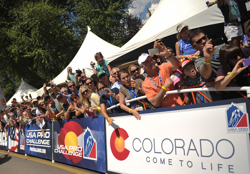 . Fans celebrate at the start of Stage 1 of the 2013 USA Pro Challenge race in Aspen, Colorado.    (Photo By Hyoung Chang/The Denver Post)