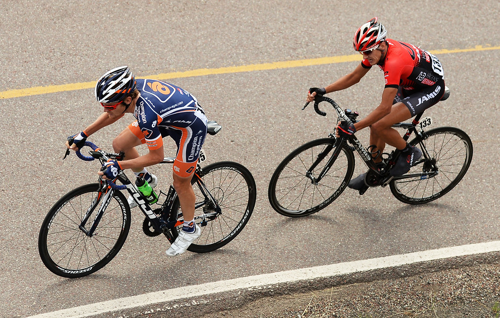 . Craig Lewis of Champion System Pro Cycling, left, and Matt Cooke of Jamis-Hages Berman p/b Sutter Home race during Stage 1 of the 2013 USA Pro Challenge race in Aspen, Colorado. Lewis was awarded Most Courageous and Cooke awarded King of Mountain. (Photo By Hyoung Chang/The Denver Post)