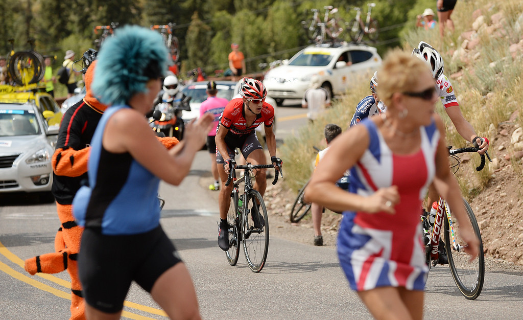 . Fans cheer the cyclists as they climbe a hill during the 60.9 -mile first stage of 2013 USA Pro Challenge race in Aspen, Colorado. (Photo By Hyoung Chang/The Denver Post)