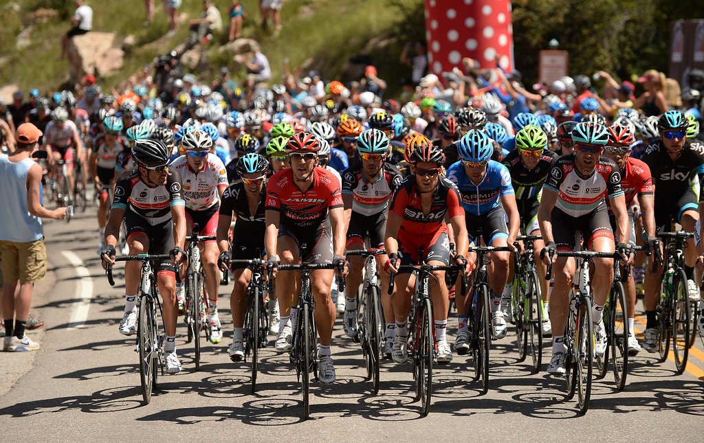 . The cyclists pass the gate of the second King of Mountain Hill during the 60.9-milei first stage of 2013 USA Pro Challenge race in Aspen, Colorado. (Photo By Hyoung Chang/The Denver Post)