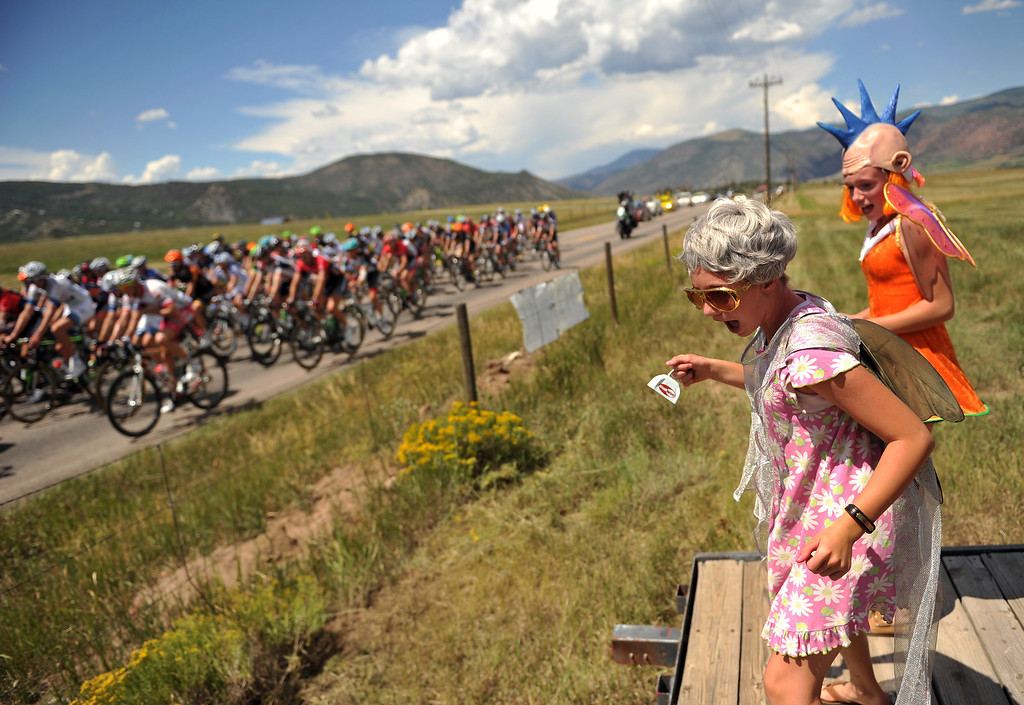 . Isiri Hughes, 10, front, and Sarah Vick, 13, cheer the pack of cyclists durin the first stage of 2013 USA Pro Challenge.  Photo By Hyoung Chang/The Denver Post)
