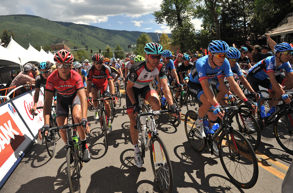 . The pack of cyclists head to Snowmass from downtown Aspen during stage one of the 2013 USA Pro Challenge race.  (Photo By Hyoung Chang/The Denver Post)