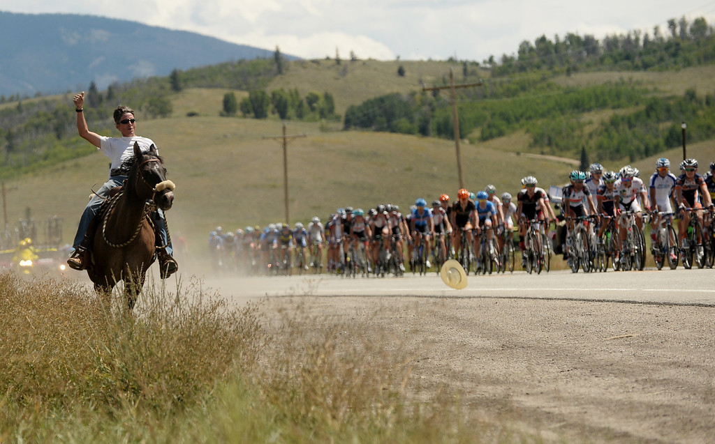 . STEAMBOAT SPRINGS, CO - August 21: John Longhill, director of Swan Center Outreach, cheers the cyclists with his horse during 106.9 mi third stage of 2013 USA Pro Challenge race from Breckenridge to Steamboat Springs. Steamboat Springs, Colorado. August 21, 2013. (Photo By Hyoung Chang/The Denver Post)