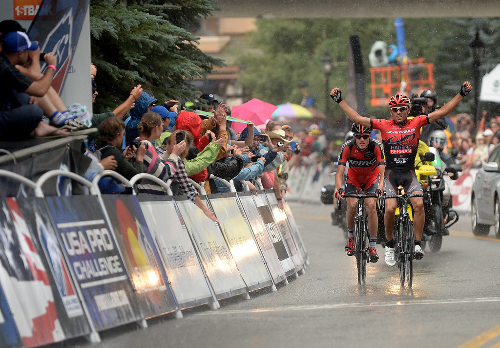 . Janier Alexis Acevedo Calle of Jamis-Hagens Berman, right, celebrates winning the 103.7-mile fourth stage of 2013 USA Pro Challenge race from Steamboat Springs to Beaver Creek. Janier Alexis Acevedo Calle won the stage and Tejay van Garderen finished 2nd and became leader of the race. (Photo by Hyoung Chang/The Denver Post)