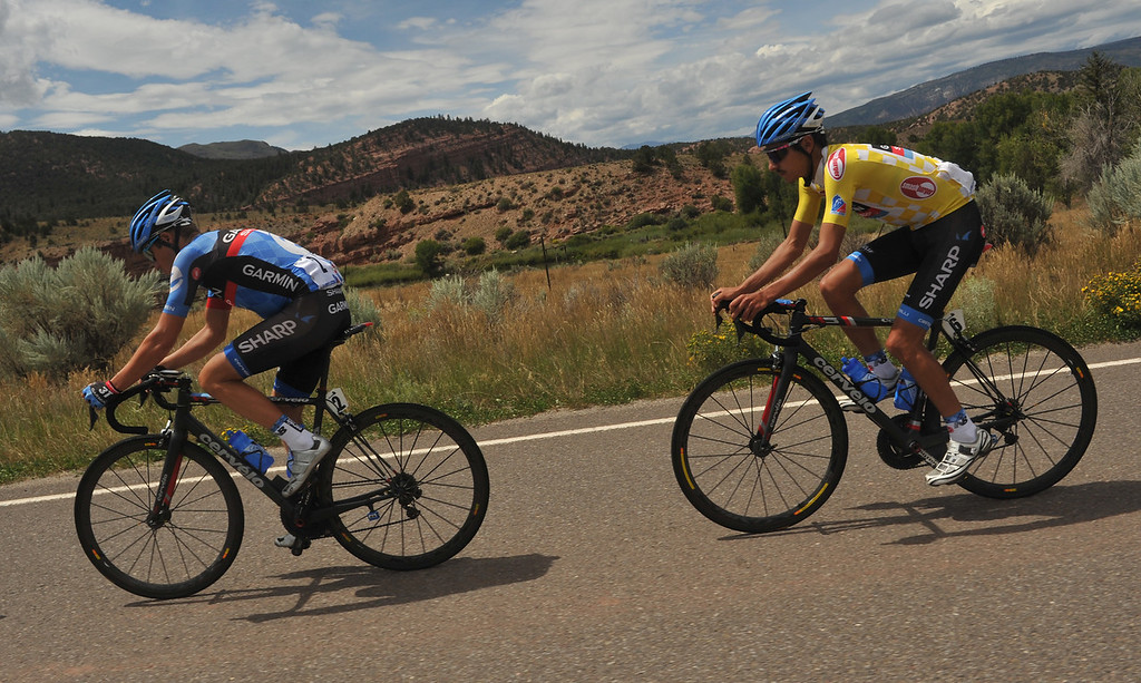 . Thomas Danielson (2), left, and Lachlan David Morton of team Garmin-Sharp go downhill after 2nd King of Mountain hill during the 103.7-mile fourth stage from Steamboat Springs to Beaver Creek, Colorado. August 22, 2013. (Photo by Hyoung Chang/The Denver Post)