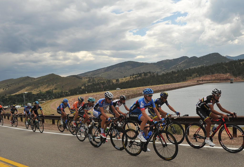 . Cyclists are climbing the hill by Horsetooth Reservoir during the 115.2 mile 6th stage of 2013 USA Pro Challenge race from Loveland to Fort Collins, Colorado. August 24, 2013. (Photo by Hyoung Chang/The Denver Post)