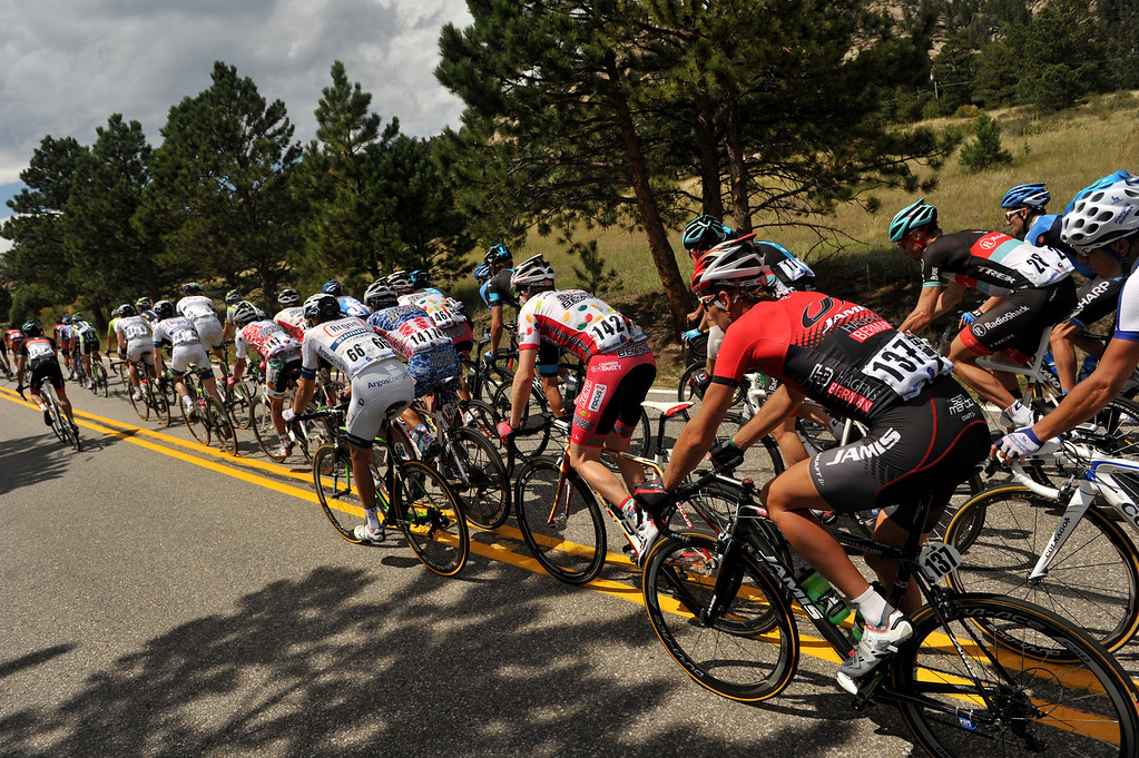 . Riders in the peloton are heading to Big Thompson Canyon during the 115.2 mile 6th stage of 2013 USA Pro Challenge race from Loveland to Fort Collins, Colorado. August 24, 2013. (Photo by Hyoung Chang/The Denver Post)