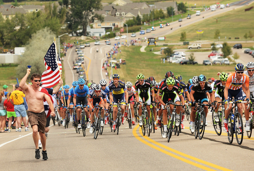. Cyclists are leaving downtown Loveland during the 115.2 mile 6th stage of 2013 USA Pro Challenge race from Loveland to Fort Collins, Colorado. August 24, 2013. (Photo by Hyoung Chang/The Denver Post)
