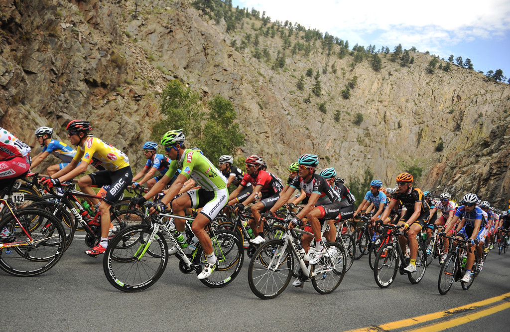 . Tejay Van Garderen of BMC Racing Team (31) and Peter Sagan of Cannondale Pro Cycling Team (51) and the pack climbs a hill in Big Thompson Canyon during the 115.2 mile 6th stage of 2013 USA Pro Challenge race from Loveland to Fort Collins, Colorado. August 24, 2013. (Photo by Hyoung Chang/The Denver Post)