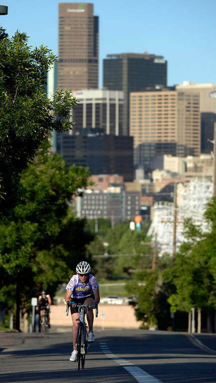 ". DENVER, CO - JUNE 9:  Tanya Berlin rides up the hill on  W. 20th Ave. next to Sports Authority Field as she participates in the ""Bicycle Bootcamp\""  on Monday, June 9, 2014. The  bootcamp readies riders for climbing mountain passes this summer.  (Denver Post Photo by Cyrus McCrimmon)"