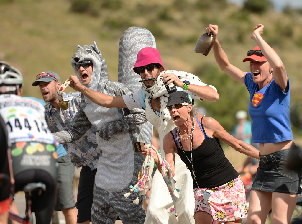 . Fans cheer Cyclists at the king of mountain during the 1st Stage of 2014 USA Pro Challenge. Aspen, Colorado. August 18. 2014. The Aspen/Snowmass Circuit is 65 miles (3 laps of nearly 22 miles each), and 2,300 ft. of climbing per lap. (Photo by Hyoung Chang/The Denver Post)