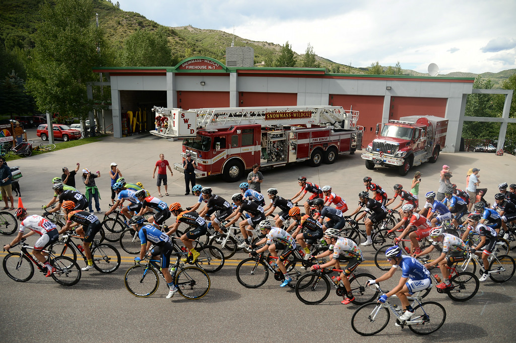 . Peloton pass by Snowmass Fire station No. 1 during the 1st Stage of 2014 USA Pro Challenge. Aspen, Colorado. August 18. 2014. The Aspen/Snowmass Circuit is 65 miles (3 laps of nearly 22 miles each), and 2,300 ft. of climbing per lap. (Photo by Hyoung Chang/The Denver Post)
