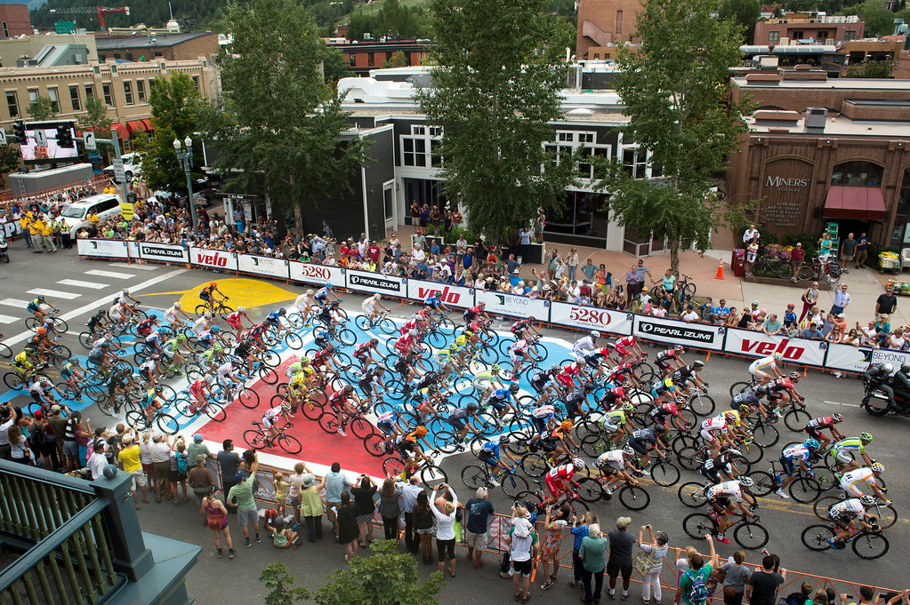 . Riders go through the second of two neutral laps through town as part of the 65-mile Stage 1 of the USA Pro Challenge on August 18, 2014, in Aspen, Colorado. The stage runs 65 miles on a three-lap circuit between Aspen and Snowmass Village. (Photo by Daniel Petty/The Denver Post)