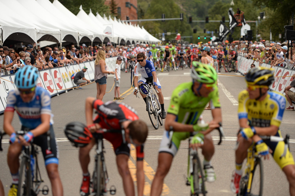 . Cyclists line start line of  the 1st Stage of 2014 USA Pro Challenge. Aspen, Colorado. August 18. 2014. The Aspen/Snowmass Circuit is 65 miles (3 laps of nearly 22 miles each), and 2,300 ft. of climbing per lap. (Photo by Hyoung Chang/The Denver Post)