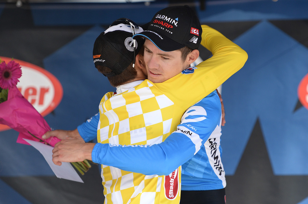 . Alex Howes of Team Garmin -Sharp from Golden, CO, right, hugs 1st Stage winner Kiel Reijnen of UnitedHealthcare Pro Cycling after the 1st Stage of 2014 USA Pro Challenge. Howes finished as 2nd. Aspen, Colorado. August 18. 2014. The Aspen/Snowmass Circuit is 65 miles (3 laps of nearly 22 miles each), and 2,300 ft. of climbing per lap. (Photo by Hyoung Chang/The Denver Post)