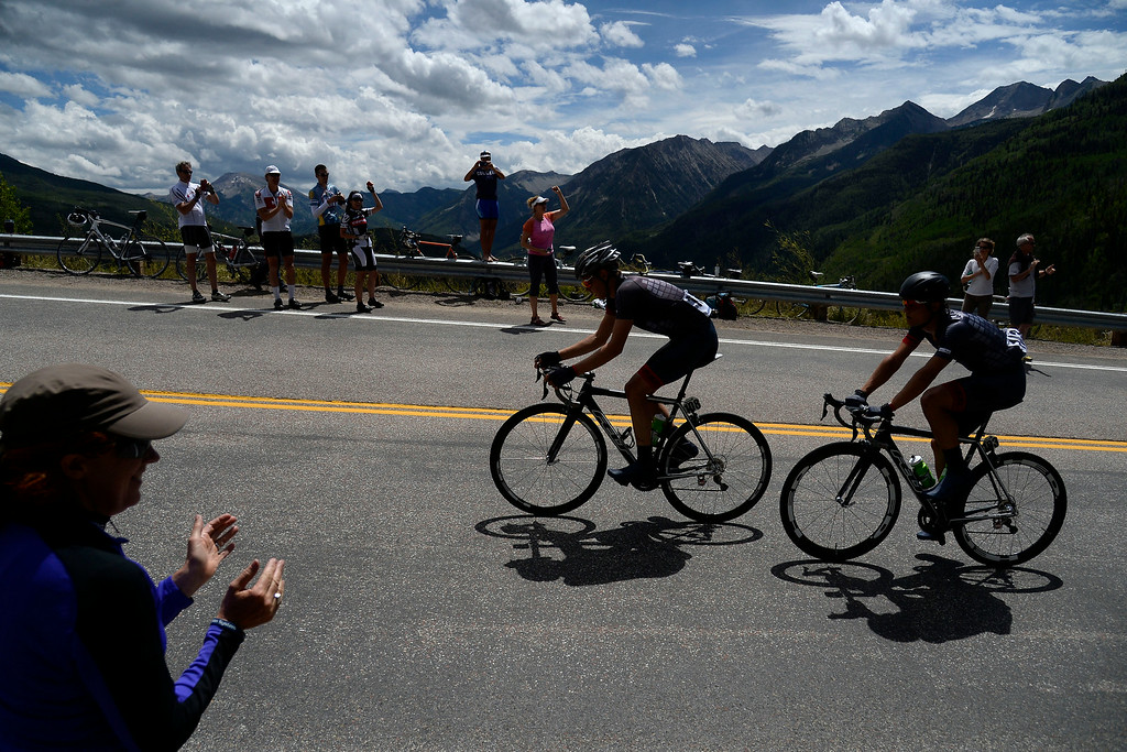 . Riders from left to right Dion Smith and Robin Carpenter battle an incline during stage 2. The USA Pro Challenge stage 2 on Tuesday, August 19, 2014. (Photo by AAron Ontiveroz/The Denver Post)