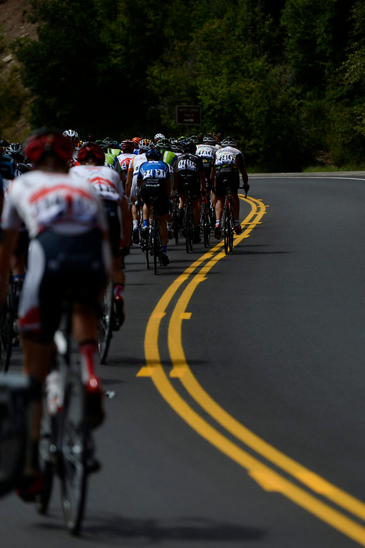 . Riders cruise the road to Carbondale during stage 2. The USA Pro Challenge stage 2 on Tuesday, August 19, 2014. (Photo by AAron Ontiveroz/The Denver Post)