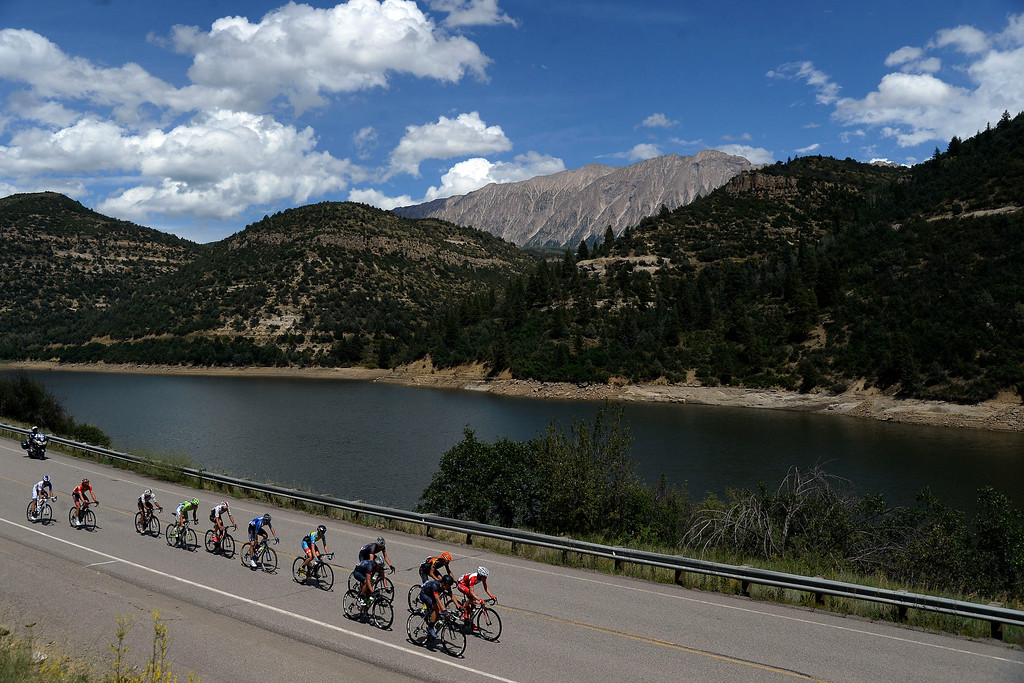 . Riders pass in front of Paonia Reservoir. The USA Pro Challenge stage 2 on Tuesday, August 19, 2014. (Photo by AAron Ontiveroz/The Denver Post)